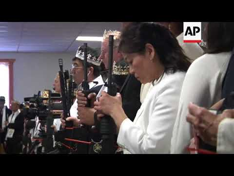 USA - Worshippers clutch AR-15 rifles at commitment ceremony
