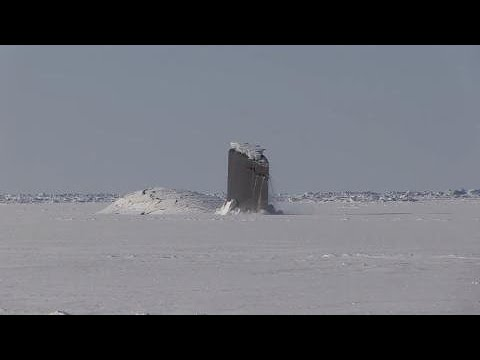 US submarines surface through ice in the Arctic