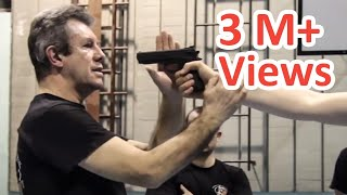 KRAV MAGA TRAINING • The fastest gun disarm technique