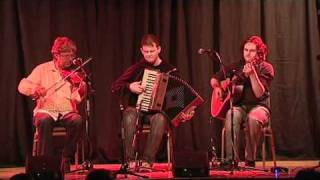 Dave Sheridan (fiddle), Ger Maloney (piano accordion), Mick Mc Cague (guitar)