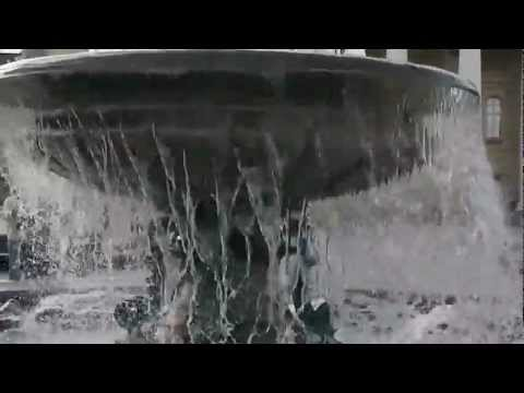 A water fountain in front of the Большой театр (Bolshoi Theater) in Moscow