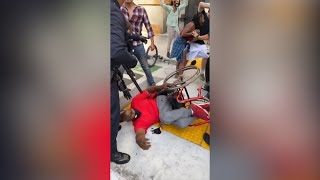 LAPD violently arrest protester in a wheelchair in Los Angeles