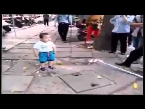 Little Chinese Boy with metal pipe defends family business against police inspectors