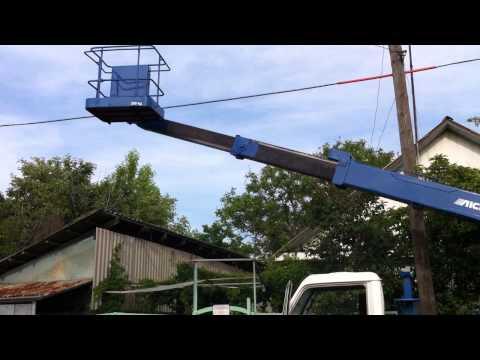 телескопическая автовышка Aichi 141, высота 14 метров, груз ть 200 кг.