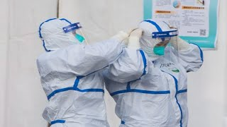 China reports a sharp spike in new coronavirus cases and deaths