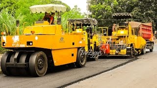 Asphalt Paver Tandem Tire Roller and Dump Truck Working