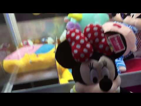 Winning the Minnie Mouse Plush Toy from a Claw Machine in Taipei