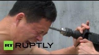 Mestre shaolin de kung-fu a prova de Tudo; não tente fazer isto em casa