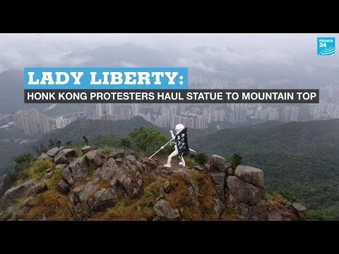 Lady Liberty: Hong Kong protesters haul statue to mountain top