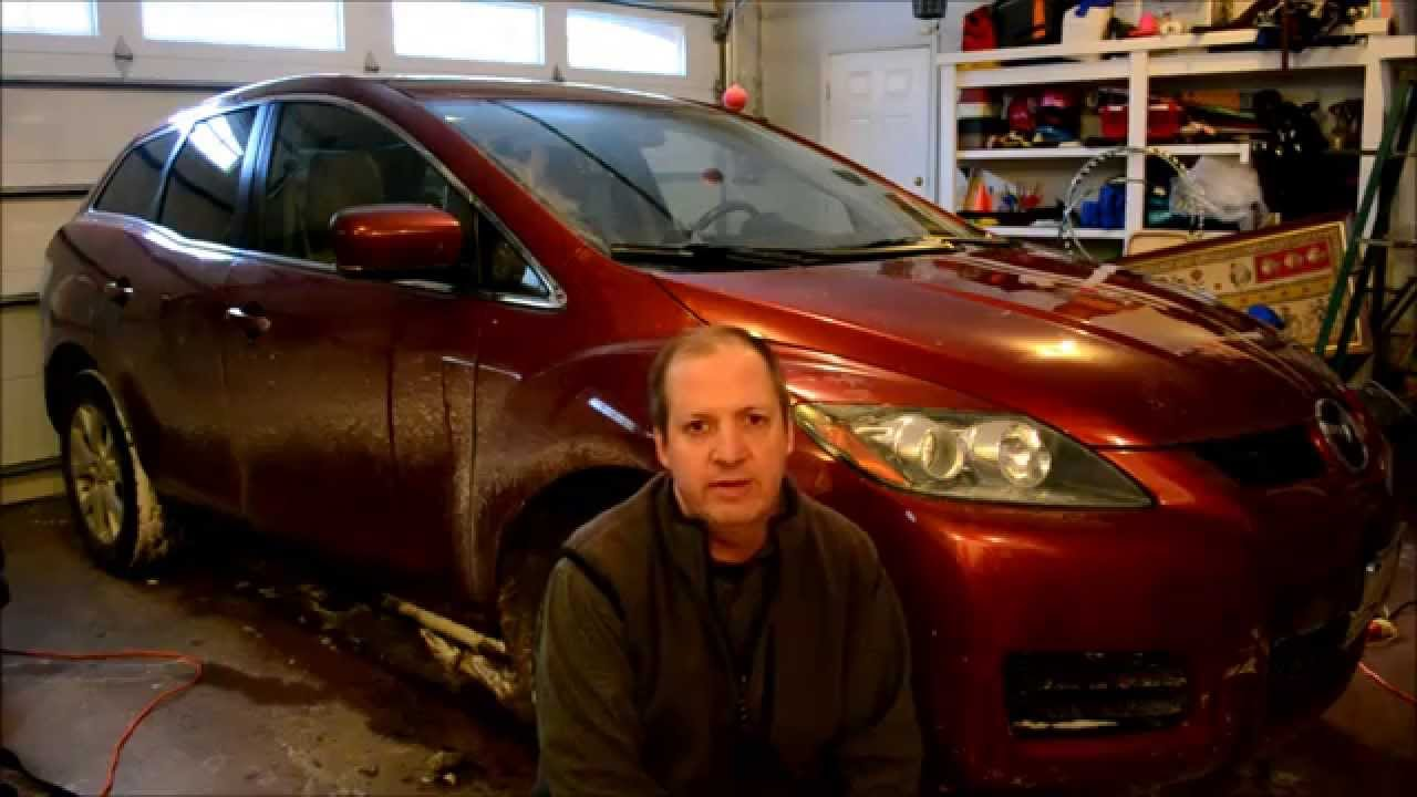How To Change Replace A Headlight Bulb In Mazda Cx 7 6 Too You