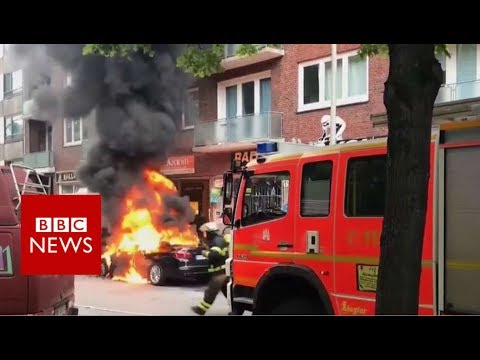 G20 SUMMIT: Burning vehicles and water cannon - BBC News