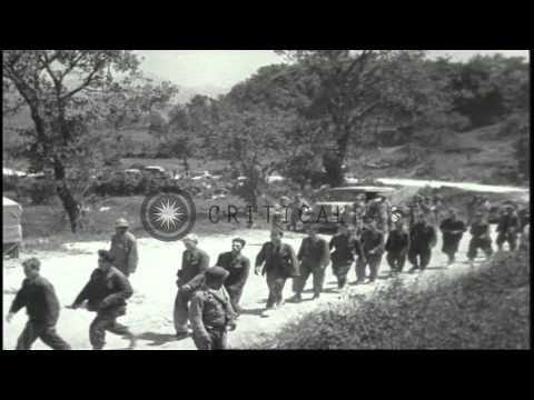 Allied troops and German prisoners in Cassino, Italy during World War II. HD Stock Footage