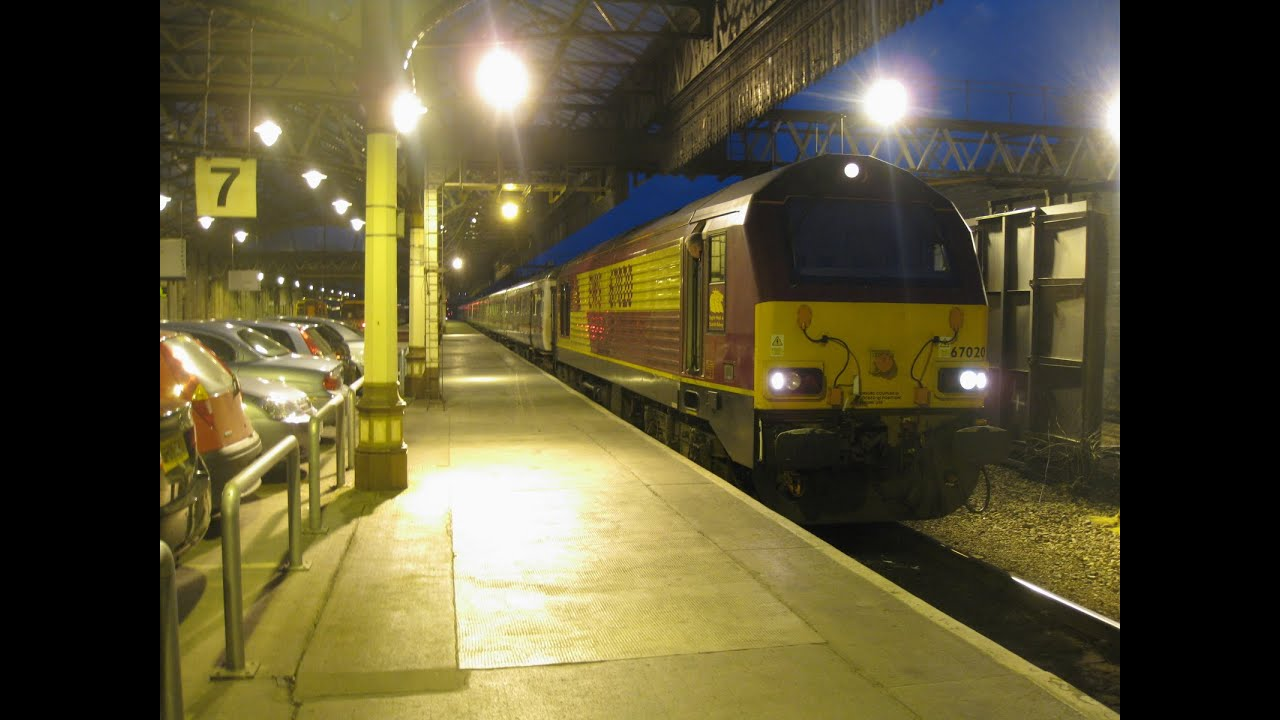Uk Scotrail Caledonian Sleeper Overnight Train Leaving Perth Station Scotland With Class 67 Loco