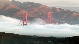 FOGGY COMMUTE: Karl the Fog taking bite out of Golden Gate Bridge