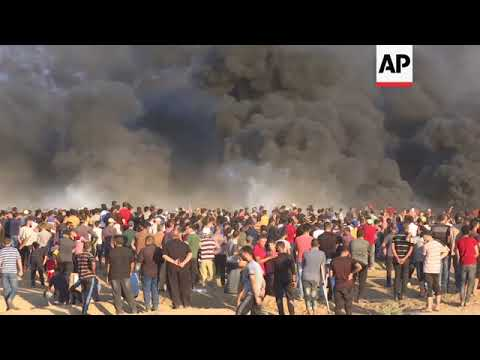 Israeli troops kill at least 2 Palestinians at Gaza border protest