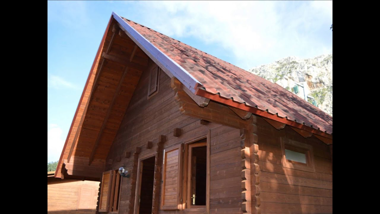Tettoie in legno foto pensiline e tettoie in legno for Come costruire un capannone moderno
