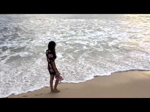 Walking along the beach of Kamburugamuwa, Mirissa in Sri Lanka