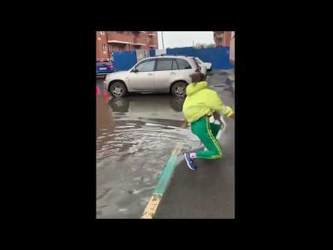 Scotty Davis - Girl Does Walking Handstand Through Puddle To Keep From Getting Shoes Wet