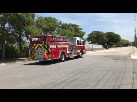 PALM BEACH COUNTY FIRE RESCUE ENGINE 93 RESPONDING FROM QUARTERS IN FLORIDA.