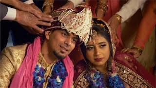 Indian stock video of newlywed Indian couple seeking blessings from their elders