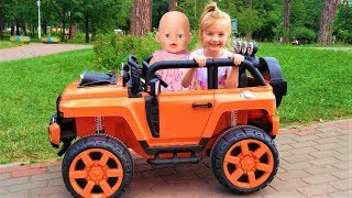 Fun cars for kids Funny Kid with Baby Born doll driving a car