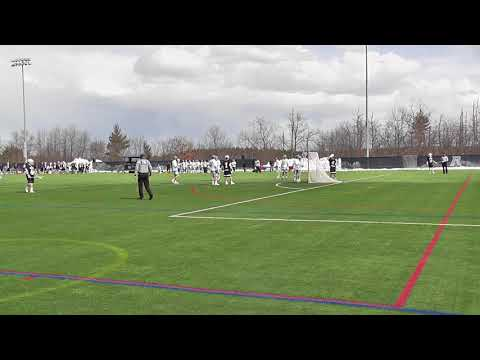 UMB's #9 Conor Lenfest crosschecked by chippy Rivier defender