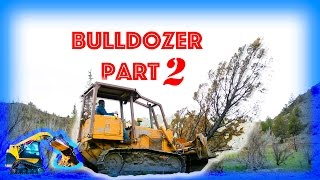 Bulldozer construction vehicle plowing trees – Moving Machines – Construction Equipment