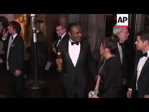 AP video appears to show man leaving Oscars ball with McDormand's trophy