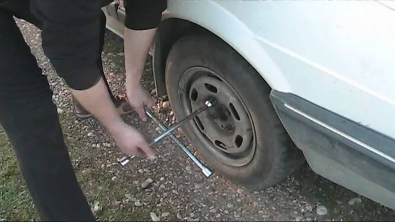 car repair guide how to change flat tire with a spare tire youtube. Black Bedroom Furniture Sets. Home Design Ideas