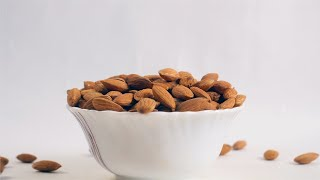 Shot of Indian almonds falling in the bowl