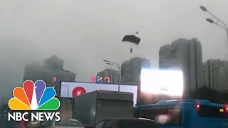 WATCH: Base Jumpers Parachute Into Busy Moscow Traffic