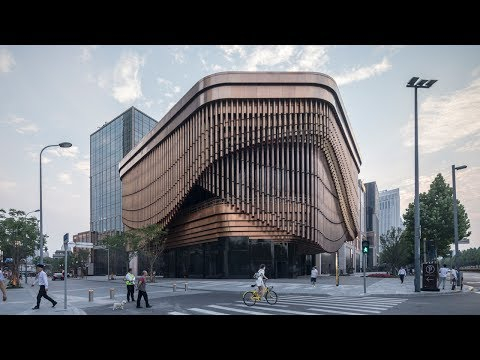 Foster and Heatherwick complete Shanghai theatre with curtai