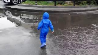 Splashing in a  rain suit Regatta Puddle IV