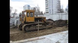 Old soviet dozer tractor T-170 and tower crane KB-504