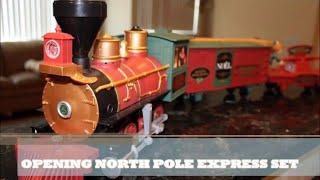Nathan opening North Pole Express Christmas Train Set