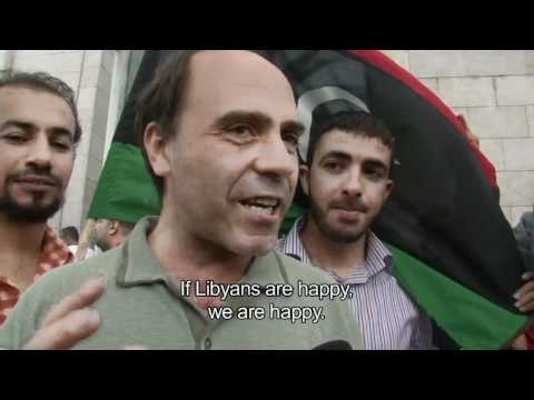 Libyans in Tunisia react to reports of Muammar Gaddafi's death