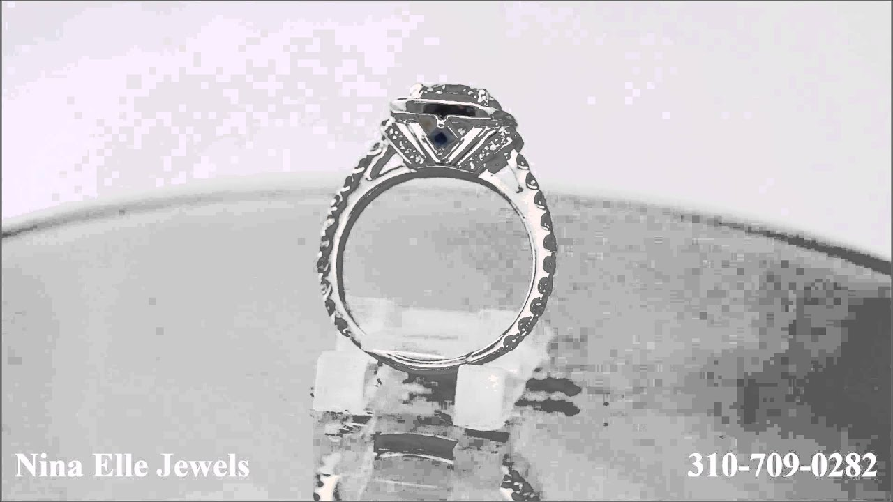 Round Cut Diamond Engagement RIng with Sappphire Accents Style