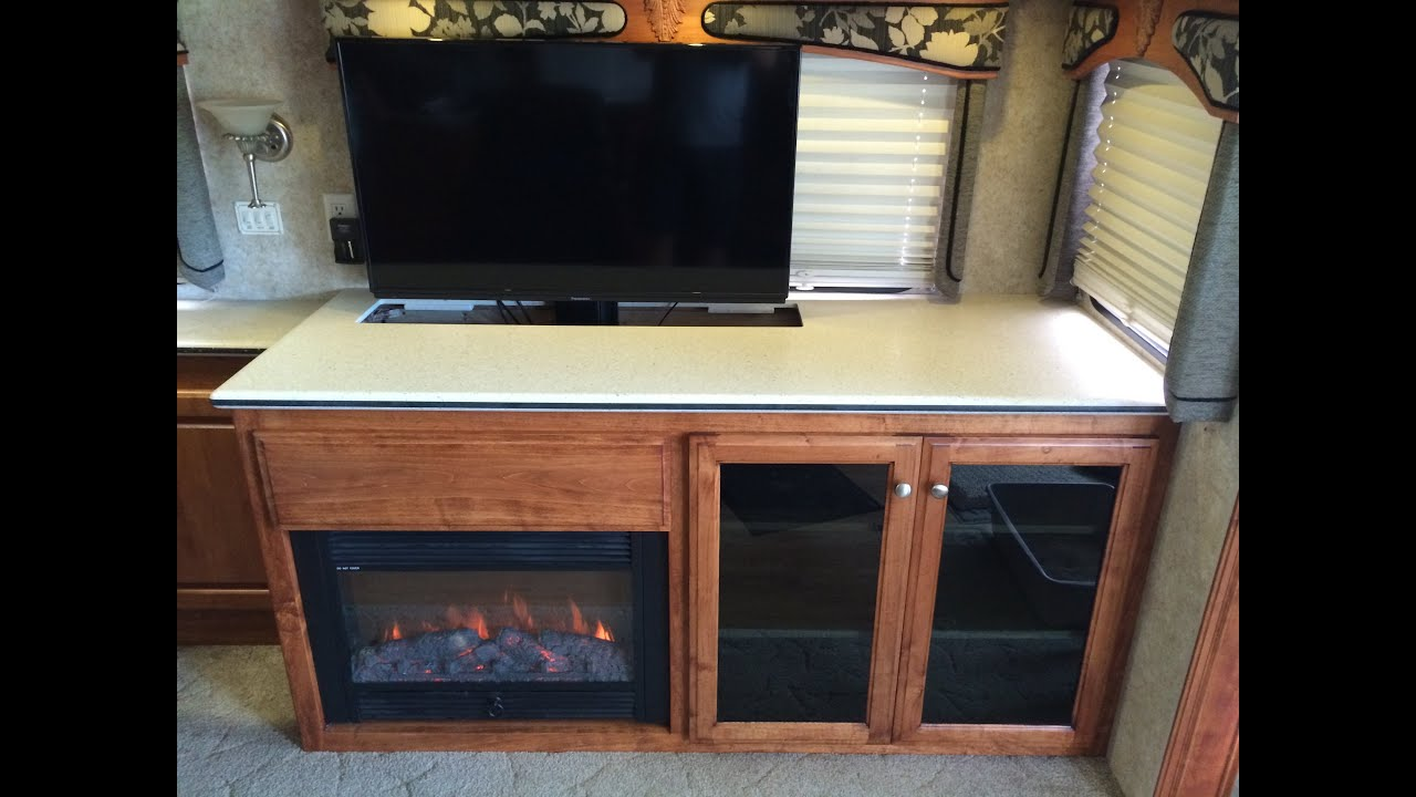 Custom RV TV, Fireplace & Storage cabinet. A Coach Supply ...