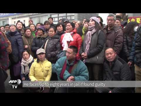 Scuffles As China Human Rights Lawyer Goes On Trial