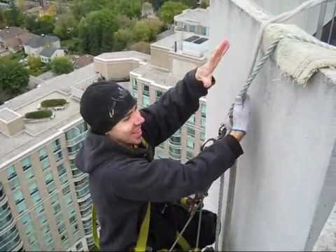 Window Cleaner Pov Captured While Hanging Off Building On