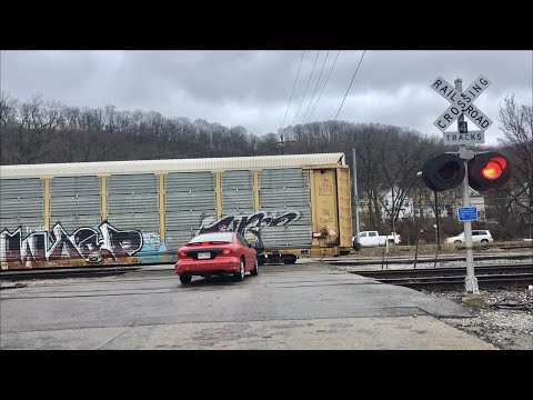 Impatient Driver Can't Wait For 2 Trains To Pass At 4 Track RR Crossing!  Caboose On 1st Train!