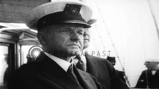 President Coolidge and Secretary of the Navy Wilbur review a fleet underway in th...HD Stock Footage