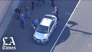 Two people arrested in alleged road rage shooting of 6-year-old Aiden Leos