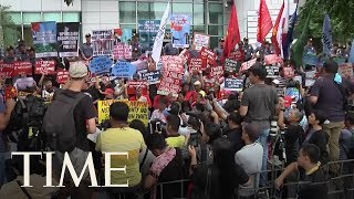 Protesters Gather As Chinese President Xi Jinping Arrives In The Philippines | TIME