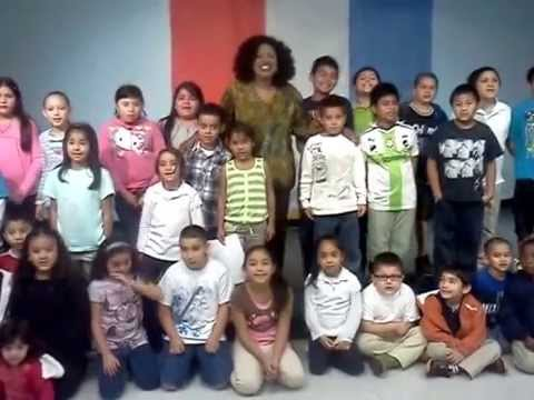 Sonia Denice taking a picture with the kids of Lorenzo De Zavala Elementary School