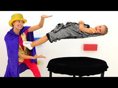 Vlad and Nikita shows mom magic tricks