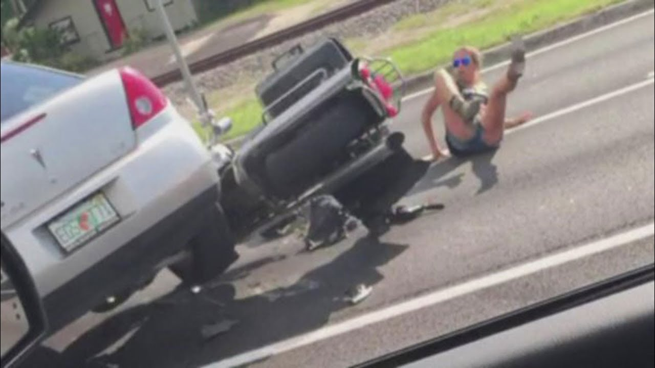 Car Runs Over Couple On Motorcycle Video Youtube