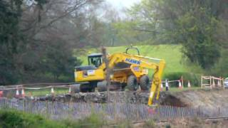 Rubber Tracked Digger on A470 near Tan Lan Llanrwst