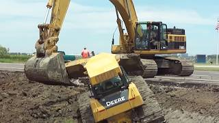 "345CL Excavator Pulls Out 2 Deere Dozers From a Canal ""Stuck?"""