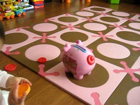 Ava Pretending To Put Coins In Her Piggybank